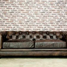 The classic Chesterfield sofa offers a touch of grandeur and elegance to any room